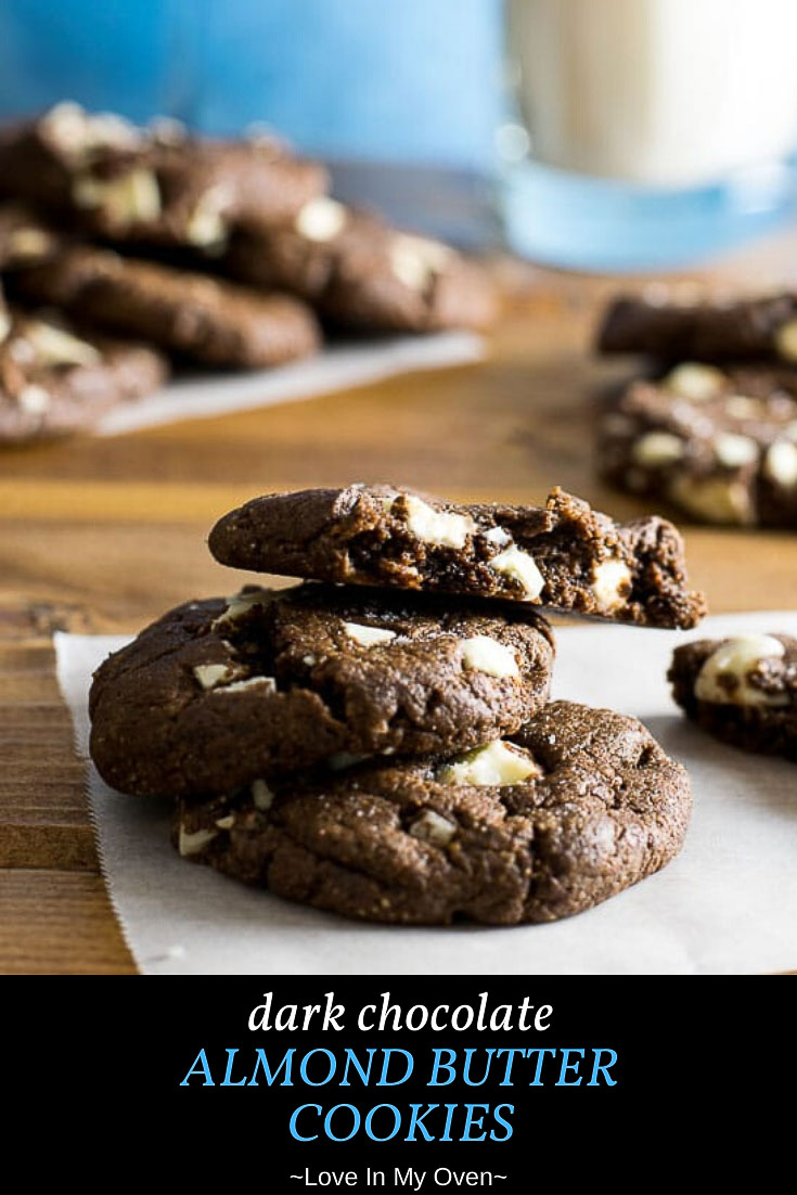 Fudgy, gluten-free dark chocolate almond butter cookies that taste as good as a brownie without all of the guilt! These almond butter chocolate cookies will be your new favorite healthier treat! // cookies using white chocolate chips // flourless dark chocolate cookies // almond butter chocolate cookies