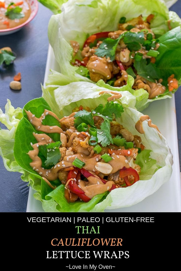 Crispy, crunchy cauliflower mixed with an assortment of veggies and coated in a mildy spicy Thai sauce, nestled into a bed of fresh, crisp lettuce leaves and drizzled with a sweet n\' spicy peanut sauce! #thaifood #thairecipes #paleo #paleorecipes #meatless #cauliflowerrecipes #lettucewraps