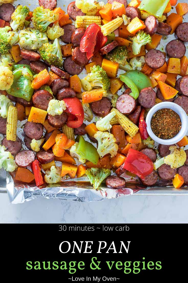 This one pan sausage and veggies dinner is the EASIEST meal you will ever make! Bright, flavorful and colorful vegetables with a simple spice mix roast up beautifully with some sliced garlic sausage! Try these sheet pan sausage and veggies for a weeknight win! // easy sausage recipes // smoked sausage and roasted vegetables